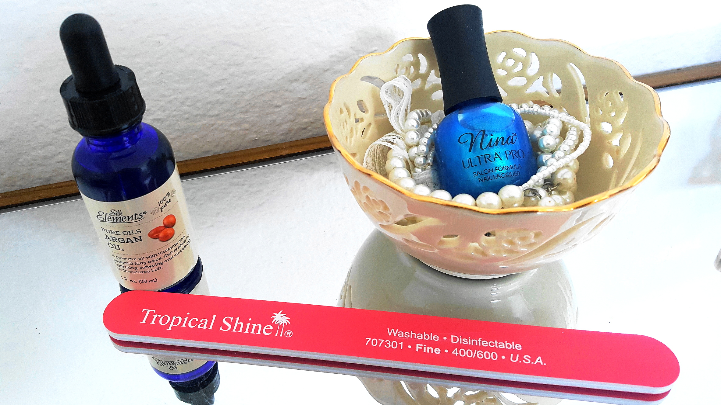Silk Elements Pure Oils Argan Oil, Tropical Shine nail file & Nina Ultrea Pro nail lacquer - Caribbean Blue